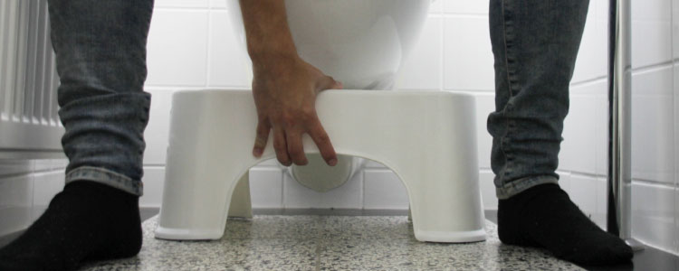 hoe gebruik je een toiletkrukje